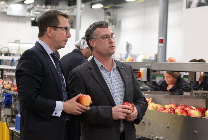 Kings-Hants MP Scott Brison, left, and Scotian Gold president and CEO David Parrish tour the new production technology at Scotian Gold in Coldbrook. Brison visited Oct. 27 to officially announce $1.75 million in federal government funding toward a 28,000 square foot expansion at Scotian Gold that has been in production since the spring of this year.