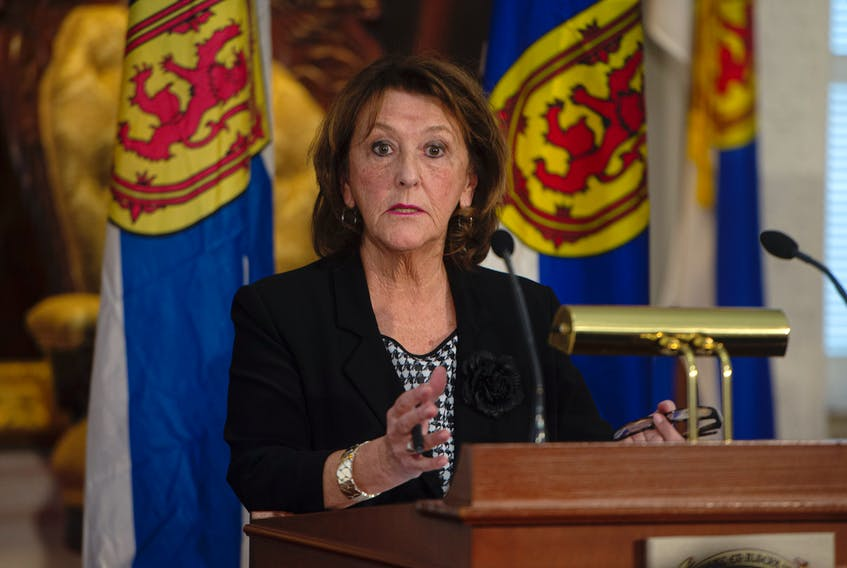 Nova Scotia Finance Minister Karen Casey answers questions from reporters about the 2020 budget at Province House on Tuesday, Feb. 25, 2020.