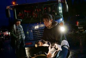Thirteen-year-old Allyson Gear does a traditional drum dance, stopping a bus heading to the Muskrat Falls construction site. Ossie Michelin took this photo during the demonstrations in October 2016.