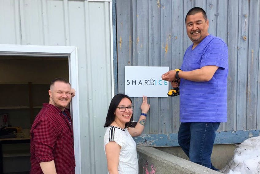 From left, Todd Perry, youth support with SmartICE; Shawna Dicker, logistics coordinator; and Rex Holwell, Northern production lead, gather outside the new facility in Nain. COURTESY OF SMARTICE INC.