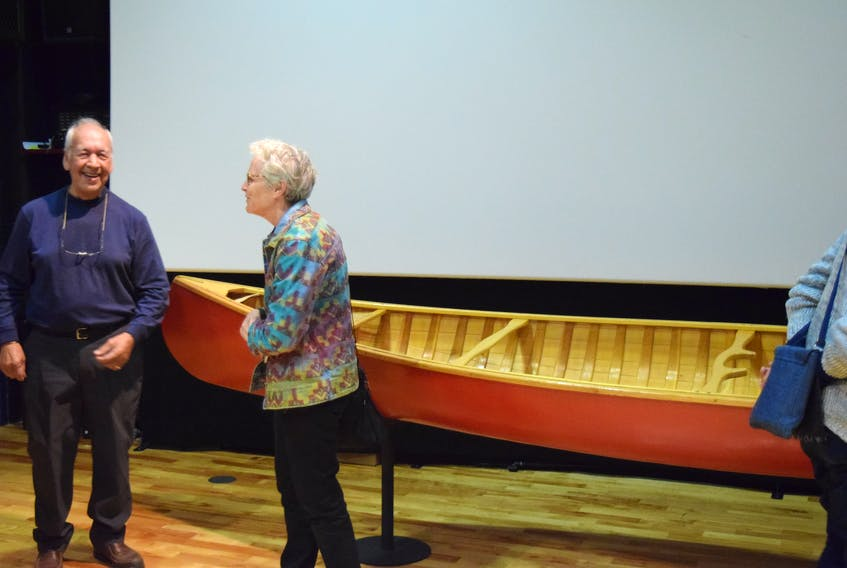 Goudie (left) talks to members of the audience following his storytelling session
