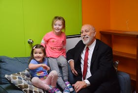 Education and Early Childhood Development Minister Al Hawkins (right) with Kaylie Webber (left) and Etta O'Brien, two of the participants in the Pumpkin House daycare.
