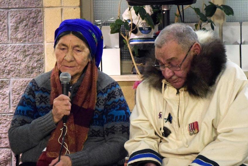 Elizabeth Penashue (left) and Ken Mesher spoke to the assembled survivors and family.