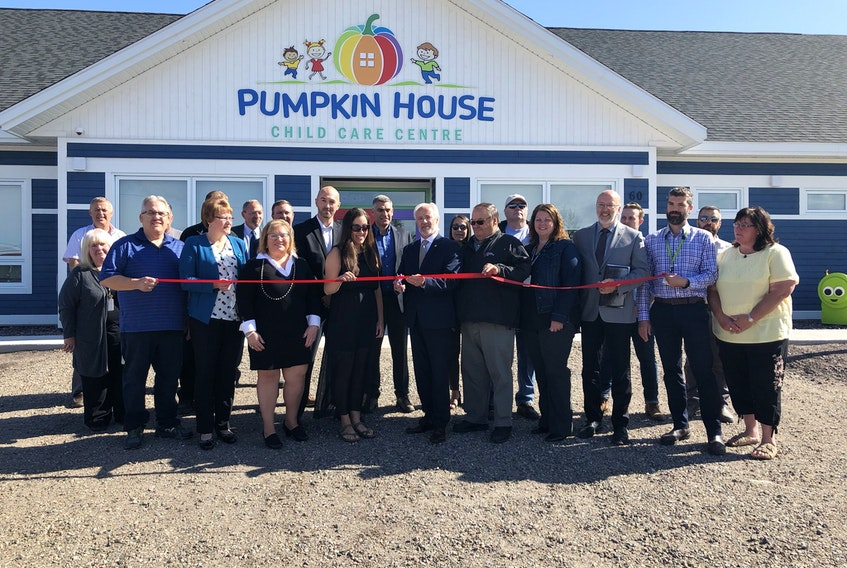 Brian Warr, provincial Minister of Education and Early Childhood Development, centre, surrounded by staff, parents, volunteers and government representatives, cut the ribbon to officially open the Pumpkin House Child Care Centre in Happy Valley-Goose Bay. CONTRIBUTED/THE LABRADOR VOICE