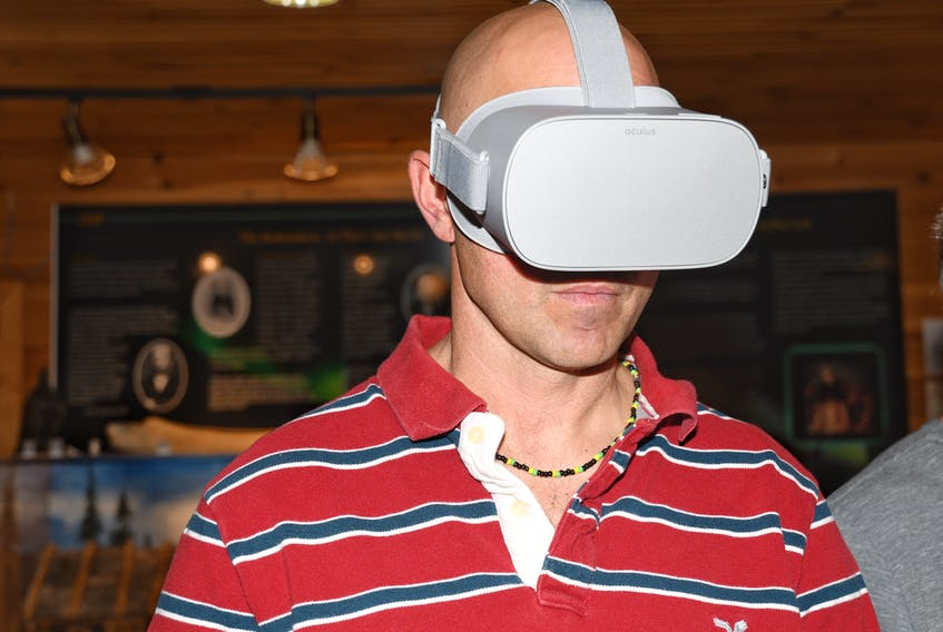 Steelworkers president Local 6731, Tony Reccord, enjoys a virtual tour of the Iron Ore Company of Canada mine. The virtual tour can be taken at Gateway Labrador. Mike Power photo