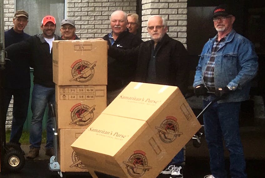 Volunteers joined in the effort to box up the shoeboxes collected from the Lewisporte-Twillingate area for Operation Christmas Child for shipping Nov. 18. Pictured are (from left) John Morris, Mike Jennings, Guy Bixby, Scott Hodder, Peter Bursey, Lewisporte-Twillingate coordinator Larry Sheppard and Wade Young. - Submitted