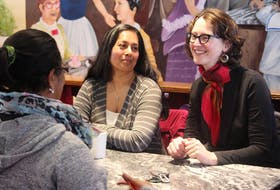 Lisa Roberts, right, NDP MLA for Halifax Needham, speaks with constituents at Julien's Patisserie Bakery & Café on Young Street.