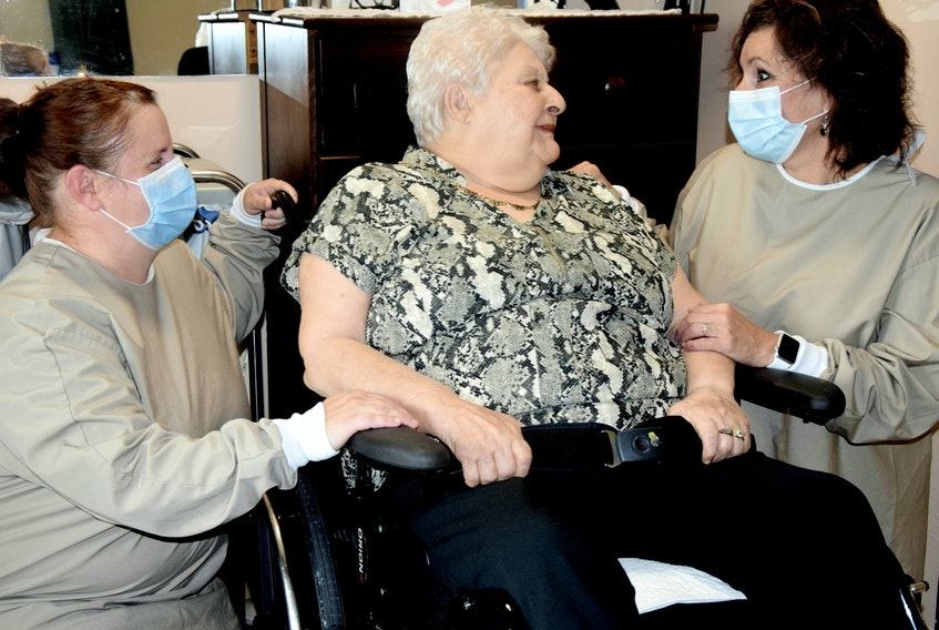 Glen Haven resident Marilyn Reddick, centre, in conversation with continuing care assistant Lead Elisha Olding-Lake, left, and Glen Haven's CEO, Lisa M. Smith. - Kimberly Dickson (Photo submitted in October 2020)