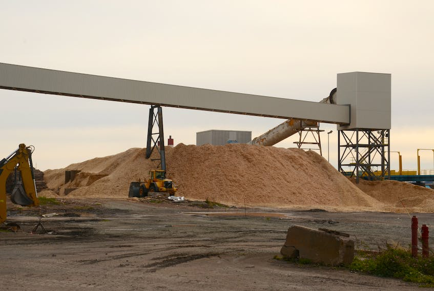 Chipped wood is piled up waiting to be burned at Nova Scotia Power's biomass power generation plant in Point Tupper, Richmond County. AARON BESWICK/ The Chronicle Herald/file