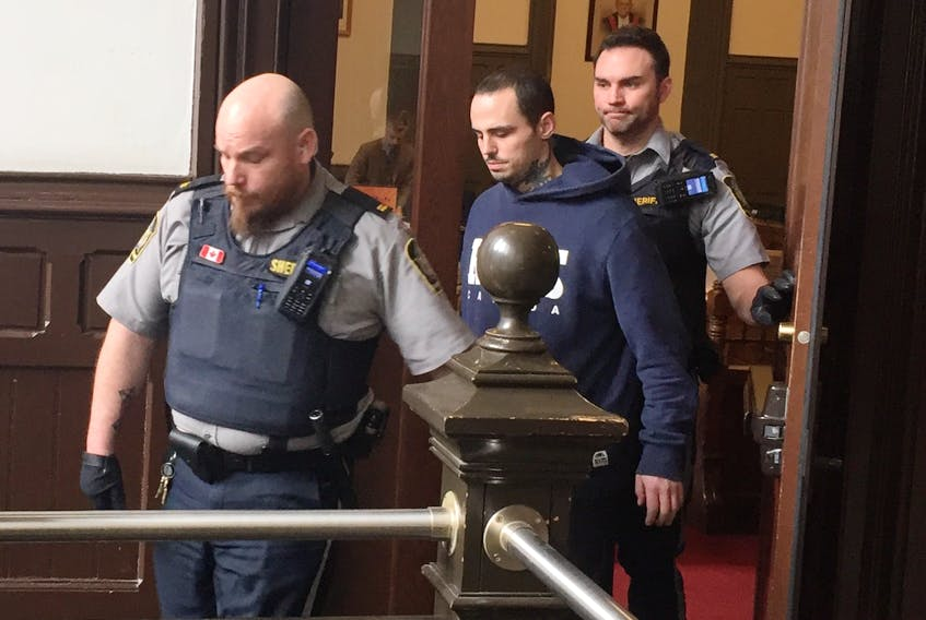 Lorne Steven Pottie is led out of Halifax provincial court Thursday after getting bail on charges of attempted murder and possession of a weapon for a dangerous purpose.