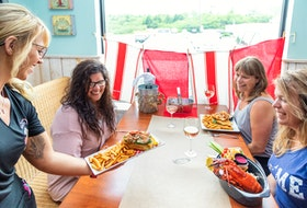 Capt. Kat's Lobster Shack in Barrington Passage is a one-of-a-kind spot known for its award-winning lobster roll and creamy lobster fondue. - Photo Courtesy Tourism Nova Scotia / Photographer: Acorn Art Photography.