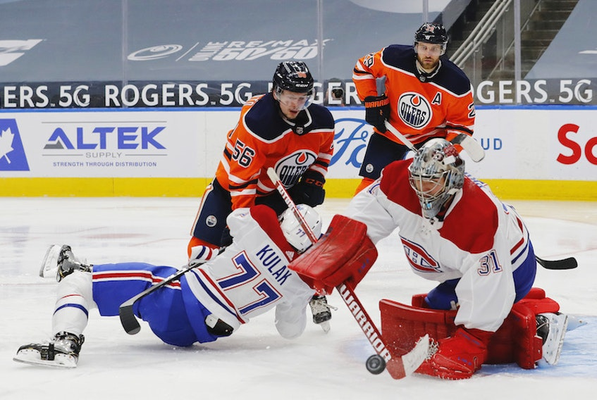 Montreal Canadiens goaltender Carey Price makes a save on Edmonton Oilers winger Kailer Yamamoto during a recent NHL game in Edmonton.