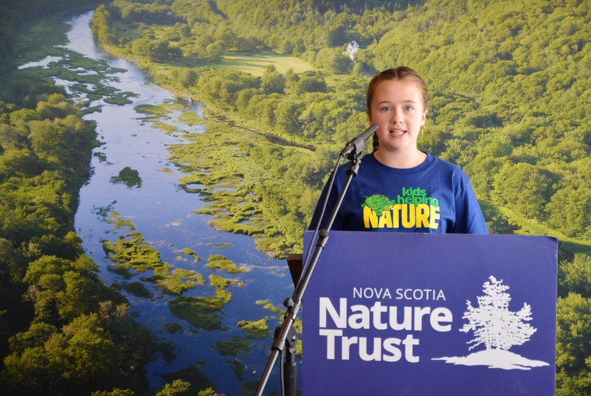 Maeve Boyne, 12, speaks at a news conference Monday, Sept. 21, to promote the Nova Scotia Nature Trust's goal of raising $4 million in donations and doubling the amount of land it has protected in the last quarter century by 2023.