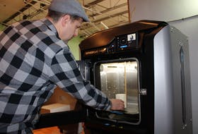 Matt Swan, the director of Nova Scotia Power Makerspace, demonstrates one of the 3D printers available at the new workspace dedicated to entrepreneurs, crafters, artisans and students at the New Dawn Centre for Social Innovation. The site officially opened to the public on Monday and will be open Monday to Friday from 9 a.m. until 5 p.m. during its first week of operation so that members of the community can check out the space.