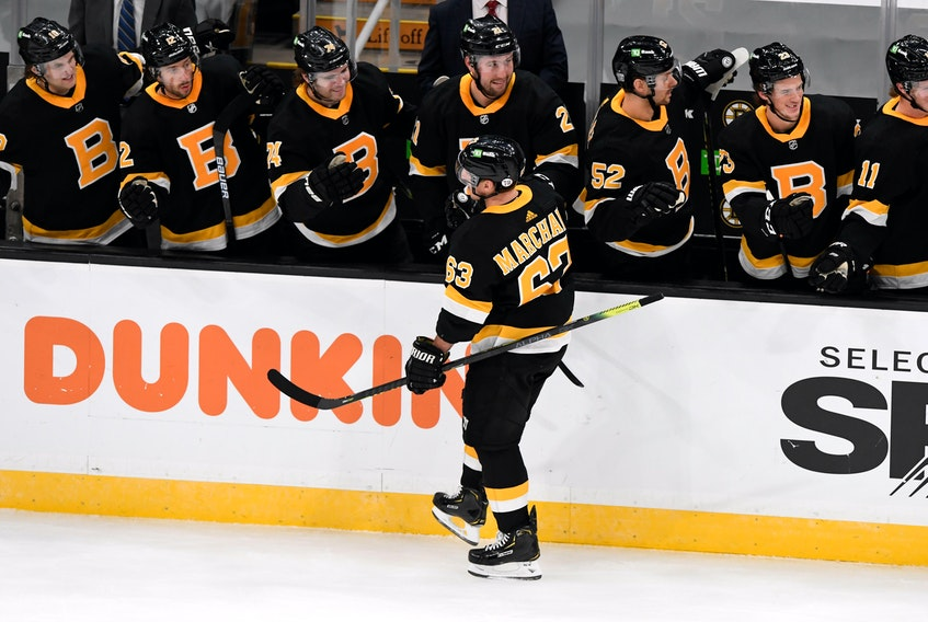 Boston Bruins forward Brad Marchand (63) celebrates with his teammates after scoring against the Pittsburgh Penguins during the first period at TD Garden in Boston. - Brian Fluharty / USA Today Sports