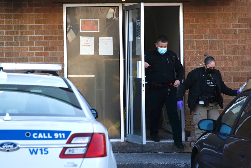 Forensics officers with Halifax Regional Police leave an apartment building at 201 Rutledge St. in Bedford on Tuesday morning, March 2, 2021. A fire there late the night before is being investigated as an arson.