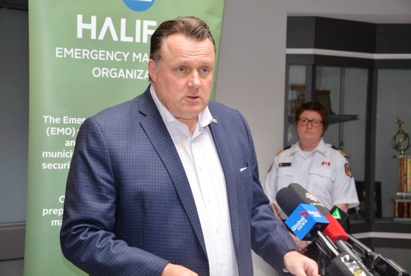 Mike Savage, mayor of Halifax Regional Municipality, outlines measures taken by the city to curb the COVID-19 threat at a news conference held Monday afternoon at a municipal building in Dartmouth that houses the Emergency Management Office.