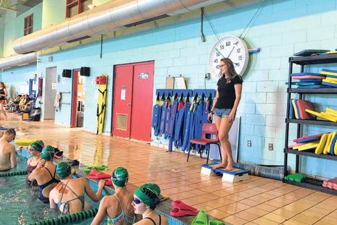 Sackville Waves head coach Zoe Miles talks to her swimmers on deck at the Sackville Sports Stadium pool.