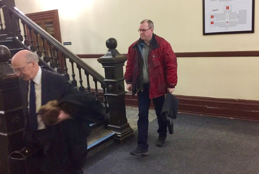 Philip Travers Milo, right, leaves Halifax provincial court with lawyer Don Murray following a February 2020 appearance on charges of possessing and distributing child pornography.