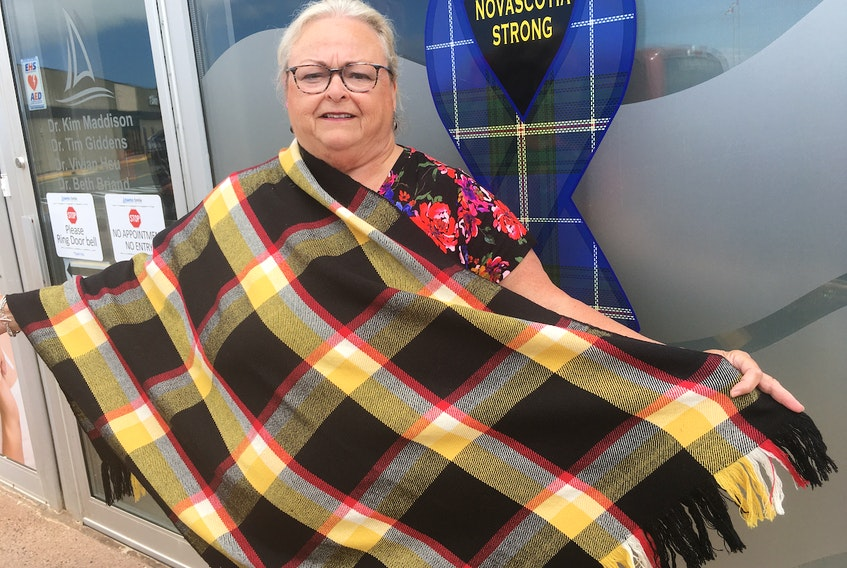 Roberta Bell displays the coal miner's tartan, Blood on the Coal, that has been recognized by the Scottish Registrar of Tartans in Edinburgh, Scotland.