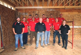 The Monk Renovations team comprised of (back row, from left) Quinn, Wannes, Cory, Ahmad, Tony (front row, from left) Rob, Matt, Dana, Dan, Rick, Darrell and Janet has won the Renovator of the Year award in 2016, 2018 and 2019. Contributed.