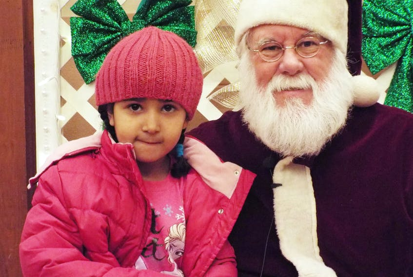 Rahmat Farag visits with Santa at the P.E.I. Association for Newcomers to Canada's Christmas open house in 2015. All are invited to take in this year's event 4-6 p.m. Dec. 12 at the Confederation Centre's Memorial Hall. SUBMITTED PHOTO