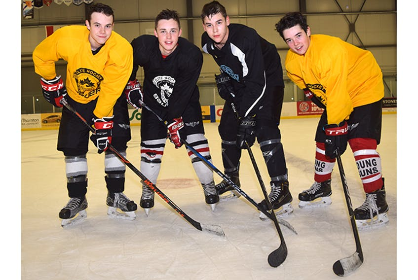 Pictou County Major Bantam Bombers captain Thomas Schnare, second from left, is shown with assistant captains Matthew Carson (far left), Calvin Denny and David Matthews.