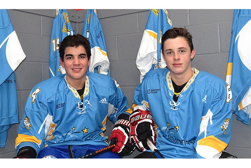 Bombers players Cale MacLaughlin, left, and Oliver Schnare show off the jerseys the team will wear during the game.