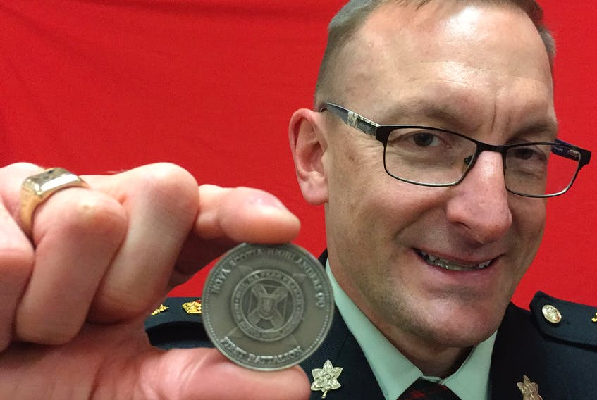 Lt.-Col. Colin Todd holds a a Nova Scotia Highlanders ceremonial unit coin that was presented to the Stellarton Legion.
