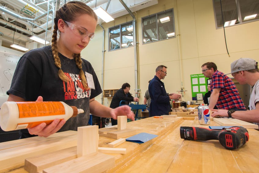Kyla Macleod from West Pictou High School tries her hand in the cabinet making shop at NSCC on Tuesday.
