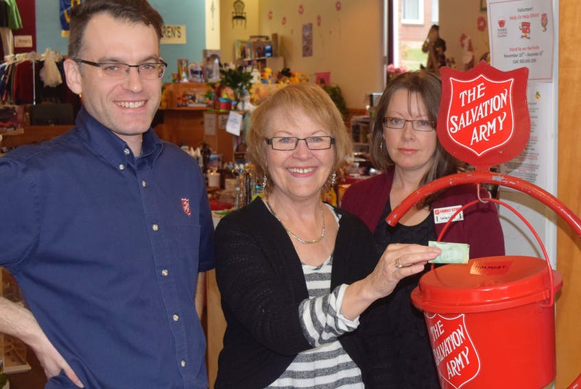 Dion Durdle, Dianne Ring and Wendy Ward, all with the Salvation Army, display one of the many kettles to be set up at businesses around Pictou County.