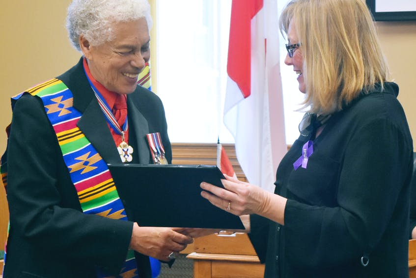 Mayor Nancy Dicks presented a certificate to Walter Borden at Monday night's council meeting in recognition of his many accomplishments.