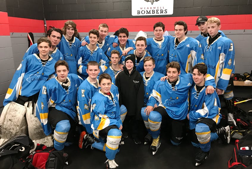 Oliver Smith, posing with the members of the Wearwell Bombers bantam team. Oliver, who is battle cancer, got his wish granted, and dropped the puck at their game against the Bedford Barons, on Saturday night.