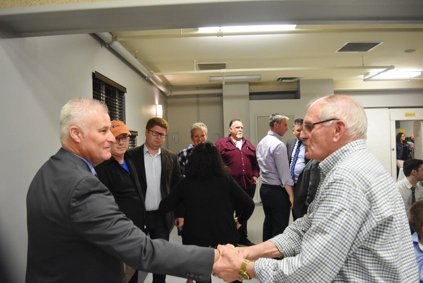 Roger MacKay shaking hands with well-wishers after it was announced that he will be the Conservative Party's nominee for Central Nova in the upcoming federal election.