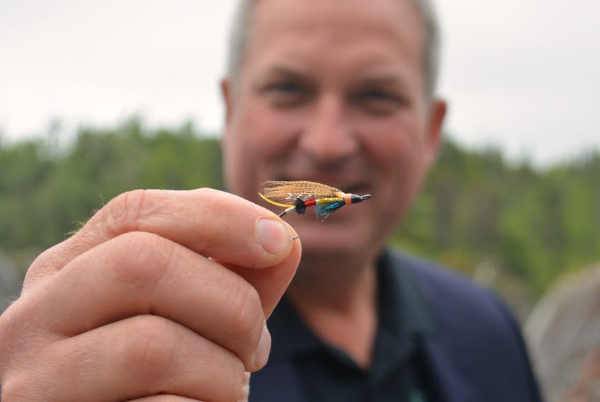 This fly dubbed the Portland Creek by creator Colby House of Massey Drive recently won the International Year of the Salmon fly competition in the designer's choice category. Here, the Portland Creek is held by Gerry Byrne, the minister of fisheries and land resources, at an announcement at the Salmonid Interpretation Centre in Grand Falls-Windsor.
