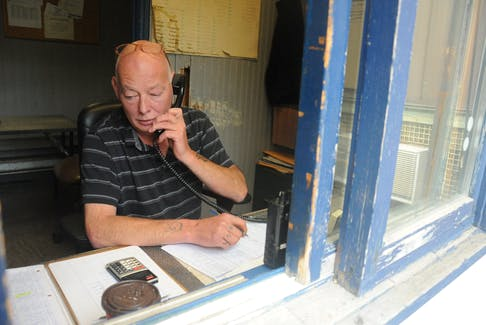 Dispatcher Ed Gaudett handles another call in the nerve centre that is the stand of Star Taxi in Corner Brook.