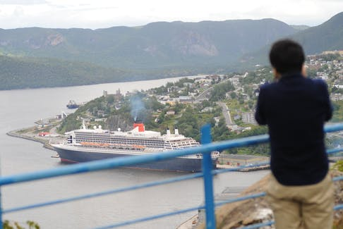 Tsubasa Nukui of Japan photographs the Queen Mary 2 from high above Crow Hill. He arrived on the ship in Corner Brook Thursday.