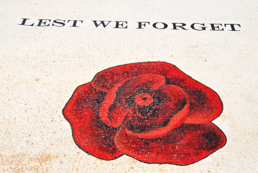 """The wording """"Lest We Forget"""" and a large poppy have been etched into the cement walk at Veterans' Memorial Square in Cape St. George. FRANK GALE/ THE WESTERN STAR"""