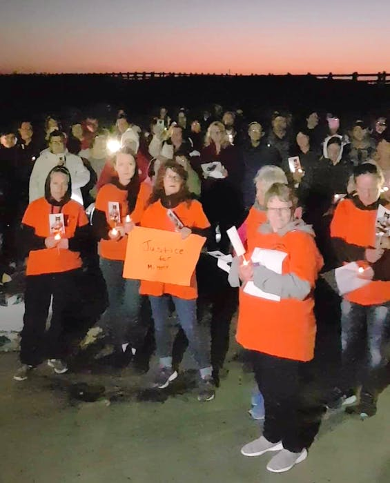 Two hundred people gathered on the beach in Grand Bay West to remember Mittens, a cat that was allegedly murdered in the community. - Contributed