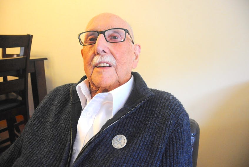 Second World War veteran Bob Grant of Corner Brook, who recently turned 100, shows off his Corner Brook Come Home Year commemorative pin.