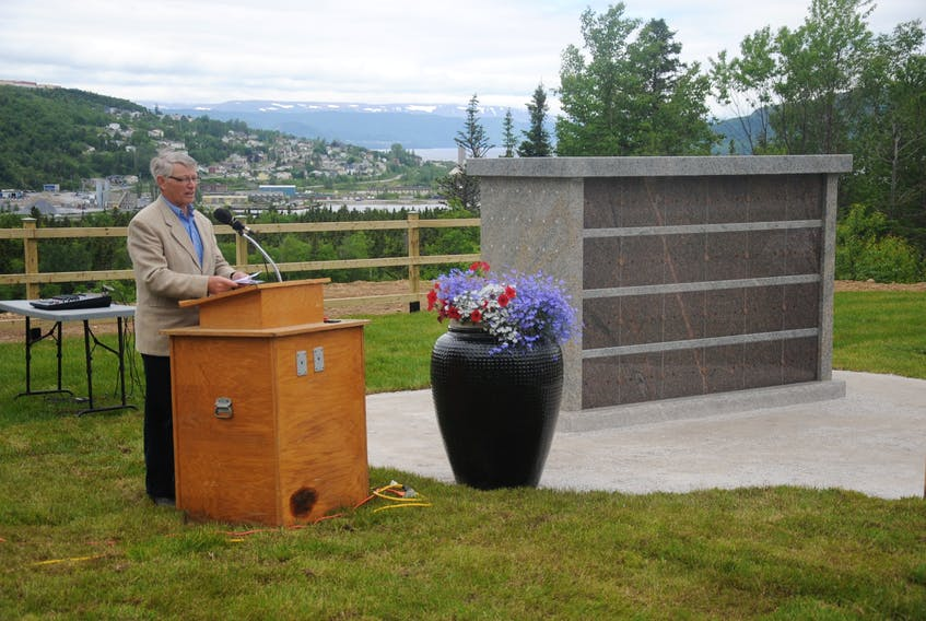 Lloyd Walters, president of the Mount Patricia Cemetery Association, emcees the unveiling and dedication of the cemetery's first columbarium Thursday. With the rising popularity of cremation, the association expects to be erecting new monuments for holding urns of cremated remains every few years from now on.