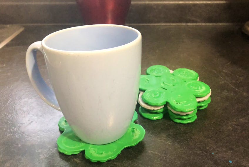 Rewind Plastics, a new Corner Brook business, is taking discarded bottle caps and turning them into new products. This flower coaster is one of the items it plans to make.
