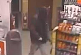 The Royal Newfoundland Constabulary are looking for the person seen in this surveillance video footage in connection with an armed robbery at a Corner Brook service station on Sunday night.