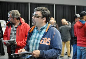 Sheldon Hatcher of Port au Port is seen chatting with a company representative from Marco Services Limited at a job fair for the construction of the new regional hospital held at the Corner Brook civic centre Tuesday.