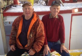 It was 53 years ago, on Dec. 20, 1965, that Finton Dobbin (left) and Delbert Mailman were stranded on Flat Island after ditching their boat in the middle of a winter storm.