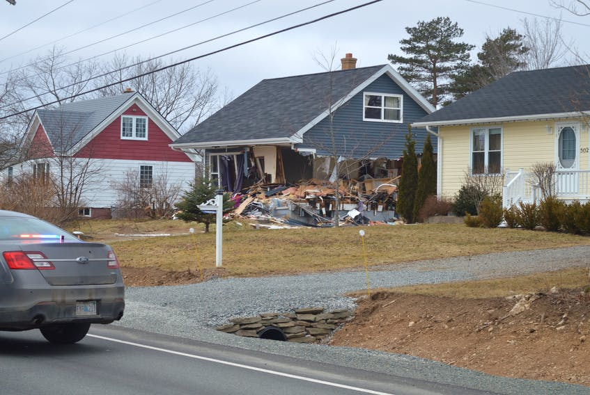 A Sydney man his in custody after a front-loader crashed through a home and an NSLC outlet Monday morning.