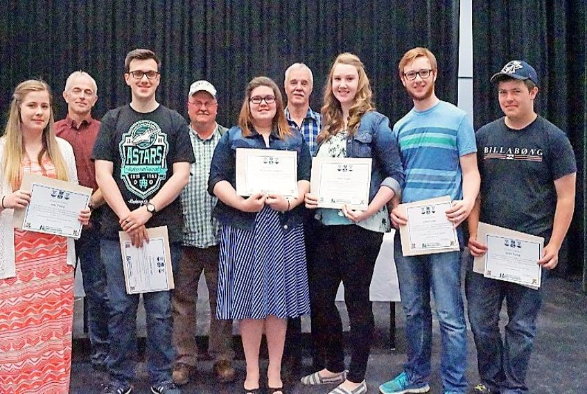 Principal Brian Hancock presented certificates to, front, from left: students Amy Young, Jonathan Lander, Wynter Rose, Emily Lander, Joshua Lander and Justin Young, back, Lorne Head (bus foreman), Tony Clarke (the bus driver at the time of the accident) on his first day on Pat Power's run, also pictured.