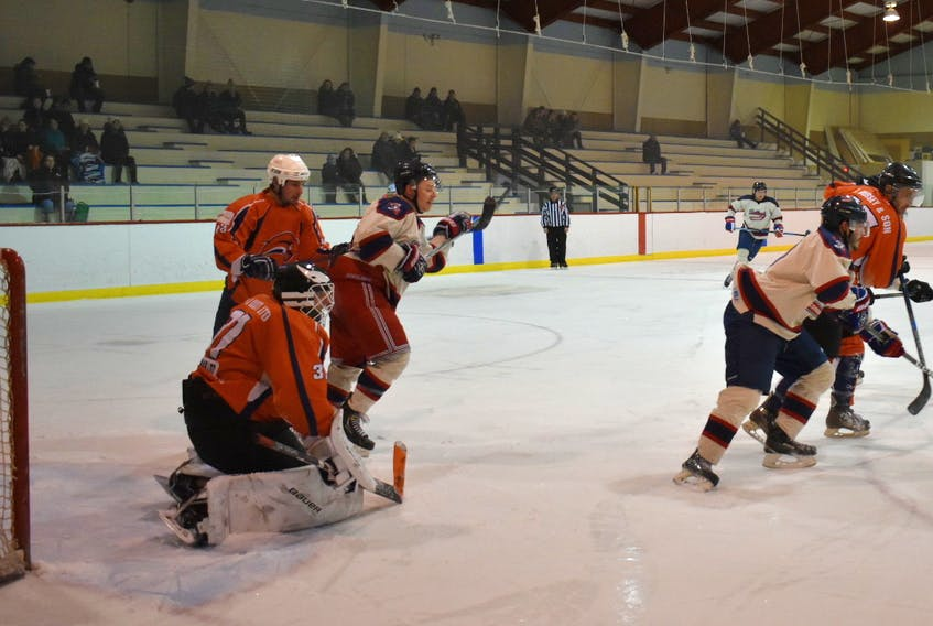 Northeast Sabres goalie Rob Roberts gets low to see through the traffic in front of the net during Sunday's Central Senior Intermediate Hockey League action in Baie Verte.