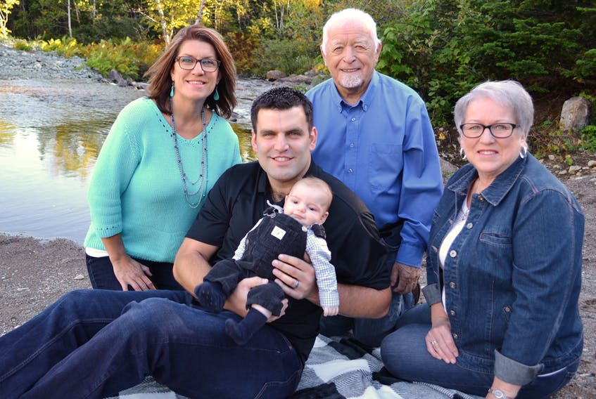 Front row: Brandon Norman holding four-month-old Cameron Norman. Back row: Cathy Norman, Malcolm Foster and Janet Sacrey