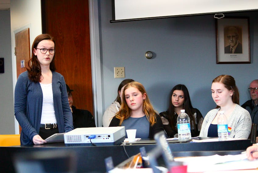 Members of the Gender Sexuality Alliance (GSA) at Indian River High, from left, Megan Paddock, Maria Lawlor, and Claudia Lilly, address members of the Springdale council tonight (April 23).
